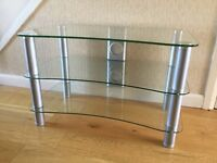 TV Stand. Clear glass, 3 shelves and silver legs. Excellent condition.