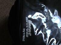 Motorcycle tank bag held with waterproof cover
