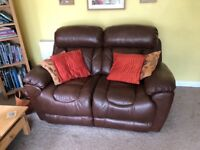 Two seater manual recliner brown leather sofa from DFS