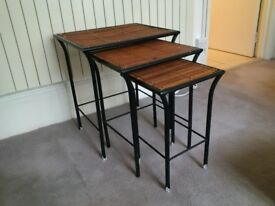 beautiful and interested nest of three tables