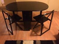Table & 4 chairs. Foldable, chairs store inside to save space