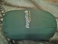 Never used sleeping bag in green colour