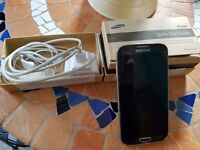 Samsung Galaxy S4 GT I9505 mobile phone with accessories