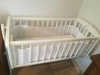 White baby swinging crib and mattress