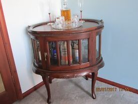 Unusual oval drinks cabinet with detachable tray