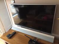 "Panasonic 40"" led smart tv with sound bar"