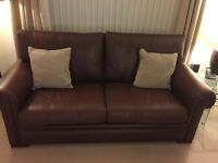 2 Brown Leather John Lewis Sofas £450.00 must collect.