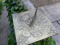 sundial solid brass depicting the four seasons nice patia would be great on stone plinth