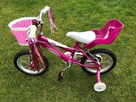 Pink girls bicycle
