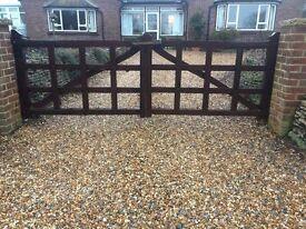 Pair of hardwood driveway gates.