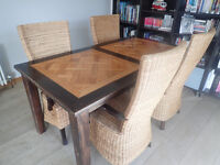 Solid wood dining table and 4 chairs (ideal for dining area or conservatory)