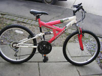 """GIRLS 24"""" WHEEL SUSPENSION BIKE HARDLY BEEN USED GREAT CONDITION AGE 10+"""