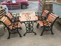 Heavy cast iron garden furniture set consisting of 4 identical chairs and table fleur de lys pattern