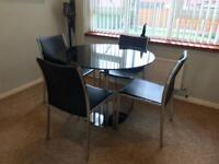 4 seater black glass/chrome round dining table with chairs
