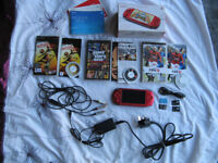 BOXED SONY PSP RADIANT RED · 3 GAMES · CHARGER PLUS USB CHARGING CABLE · AV CABLE · 2 MEMORY CARDS