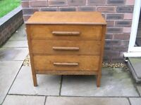 A vintage oak chest of three drawers.
