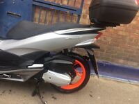 HOnda PCX 125, 2014 in very good condition for sale £1800 negociable With helmet