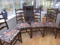 A SET OF 4 SOLID WOOD ERCOL DINING CHAIRS