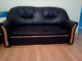 Excellent design 2-seater black leather sofa in good, clean condition from a pet free home