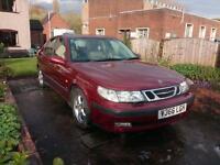 Red Saab 95, Automatic, 2L Petrol