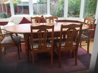 Solid pine Dining table and 6 upholstered chairs excellent condition been covered up since new