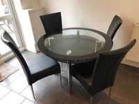 Glass Dining Table and 4 Leatherette Chairs - FREE - collection only