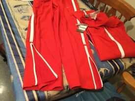 NIKE JOGGERS BRAND NEW WITH TAGS size medium 10/12. Ankle zip & 2 front/rear pockets. NOW REDUCED.