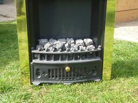 electric fire insert with brass surround and coal effect