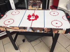 Air hockey table with scoreboard