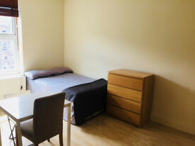 053T-WEST KENSINGTON- DOUBLE STUDIO FLAT, SINGLE PERSON, FURNISHED, BILLS INCLUDED - £200 WEEK