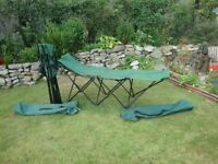 X2 folding camp beds. Green. Only used twice. Stored in own bags with carry handle. 2 for £30!!!