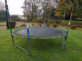 Garden trampoline. 10 feet in diameter. All in good condition. Posts for net but no net.