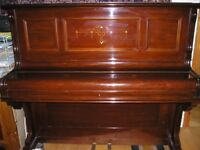 Upright re-polished piano.