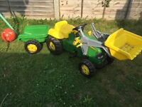 John Deere sit and ride pedal tractor and trailer