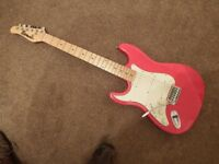 Lest handed strat style guitar red