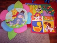 3 different play mates for a baby, ie. The Jungle and Disney Winnie The Pooh.
