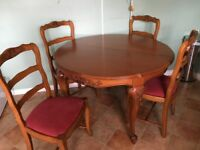 Carved extending table and 4 matching chairs