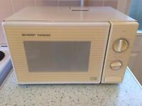 Sharp white and cream microwave
