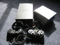 Playstation 2, with 2 controllers,cables etc and lots of games