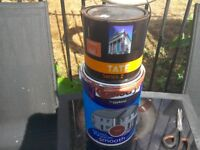 Two tins of paint