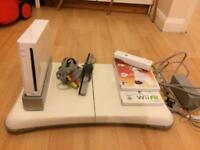 Nintendo Wii with fit board. 2 games