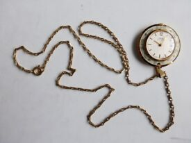 Oris ladies pendant watch with chain.