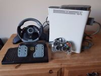 X Box 360, MC2 Mad Cats Steering Wheel and pedals and 21 games with blue glowing wired controller