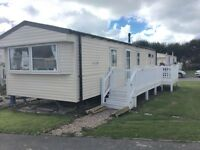 Cheap nearly new caravan including deck and all site fees until 2018 in mid- wales