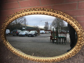 Large Gold Framed Mirror , in good condition . Size 30in Height and 41in width.