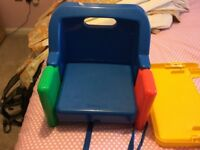 Portable high chair.Easy to carry.Can be placed on a chair or stand alone.