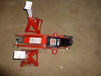 Two ton capacity trolley jack and two unused axle stands