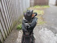 set of ping black eye golf clubs and ping trolley bag
