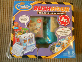 Rush Hour Traffic Jam Game Jr. by Thinkfun, suitable ages 6-8 yrs. Complete in box and travel bag.