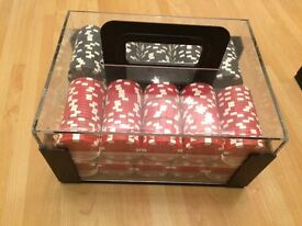 two sets of poker chips ...8 full trays in protective carry cases